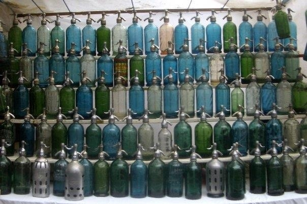 vintage soda bottles at the san telmo antiques market in buenos aires