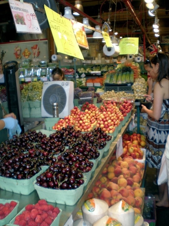 admiring the fruit at granville island public market in vancouver