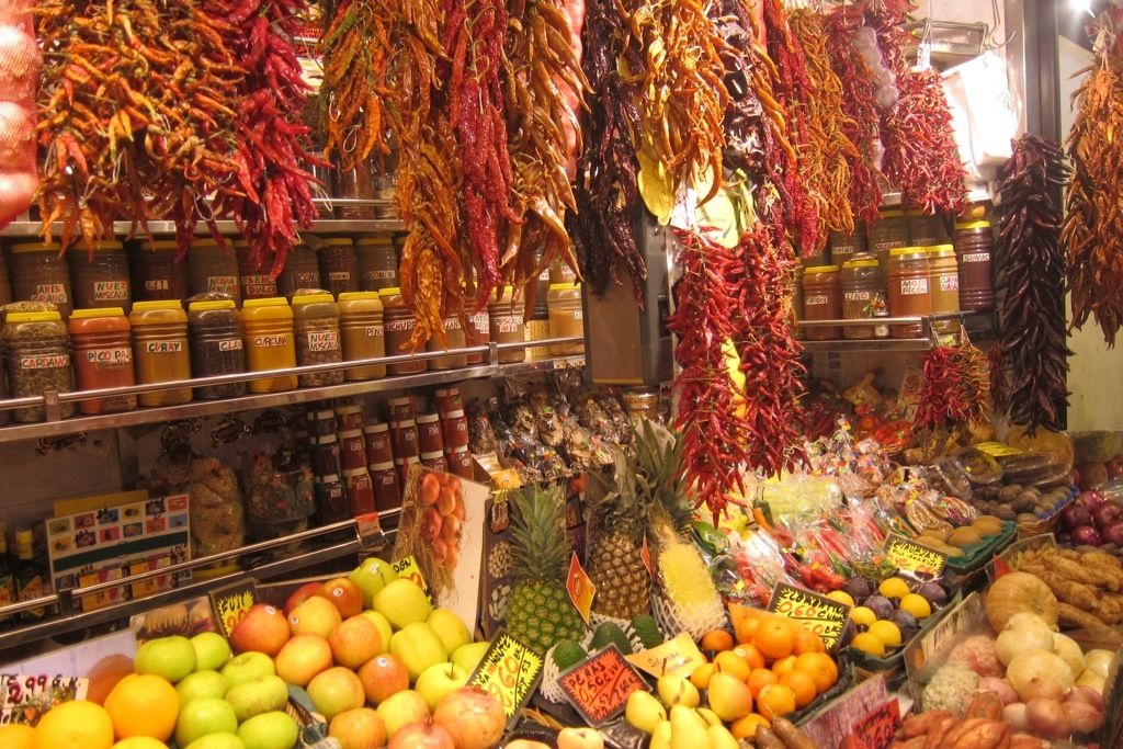 spices and chilies and fruits, oh my! at la boqueria in barcelona.