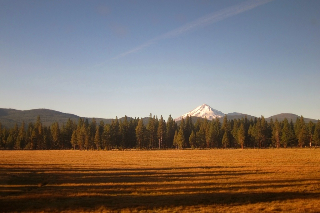 view of mount shasta in northern california from the coast starlight