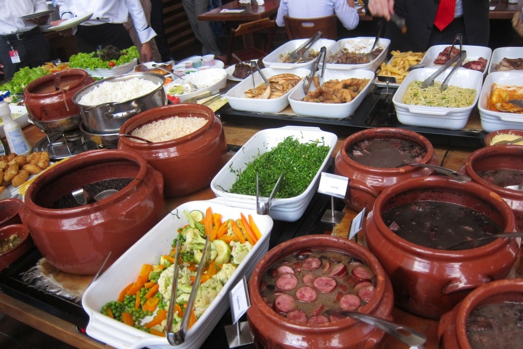trying brazil's famous local feijoada with brazilian coworkers during a work trip to brazil last year