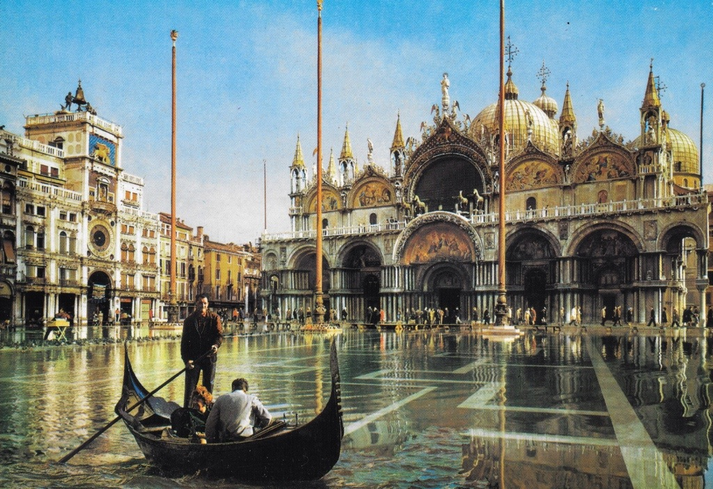 i bought this postcard while i was there - stunning! it is framed in my office. st. mark's floods each year, and people must either boat across or walk across narrow benches that line the perimeter (see the background)