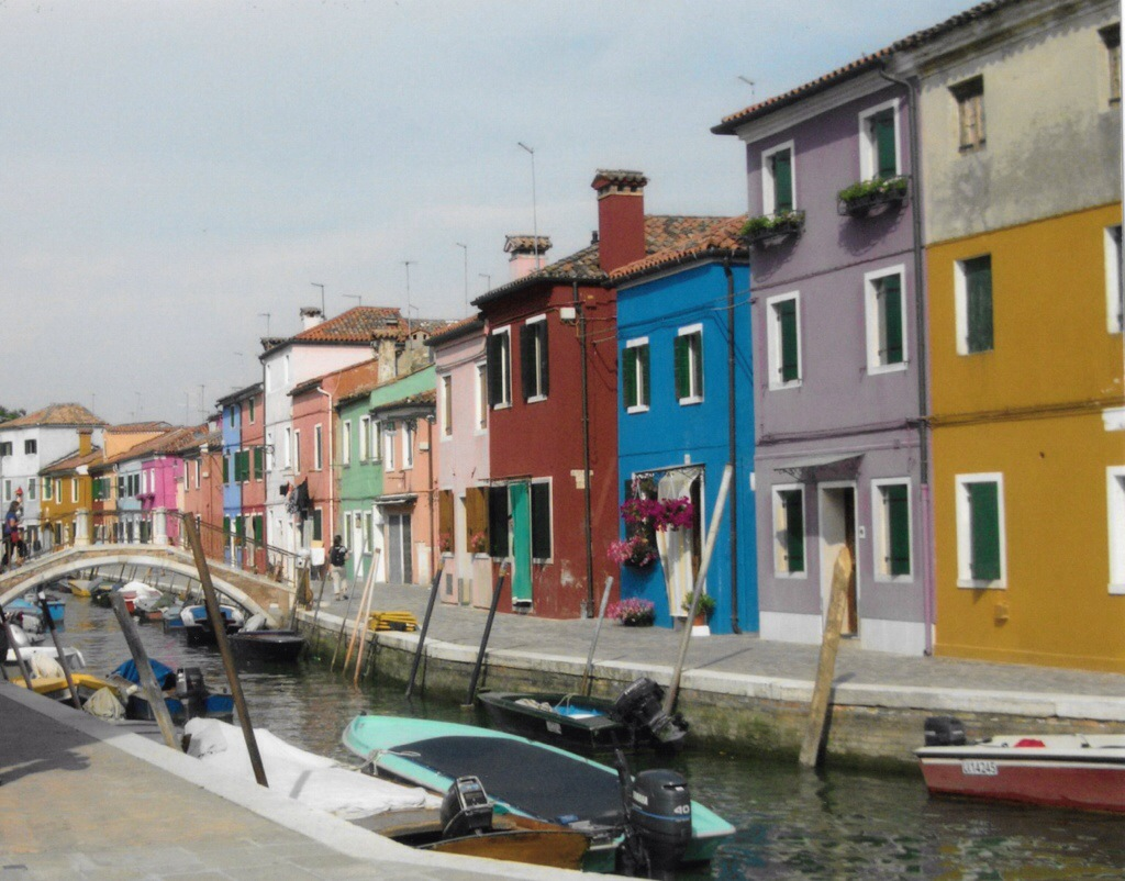 colorful houses and boats in burano, italy, just a quick boat ride away from venice