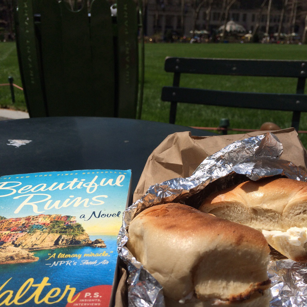 a bagel and a novel (thanks, bagel & schmear) during a quiet morning in bryant park