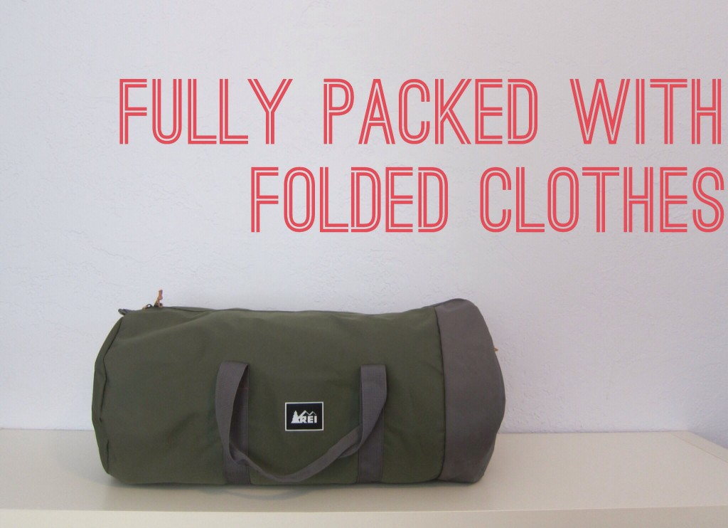 the packed bag with folded clothes