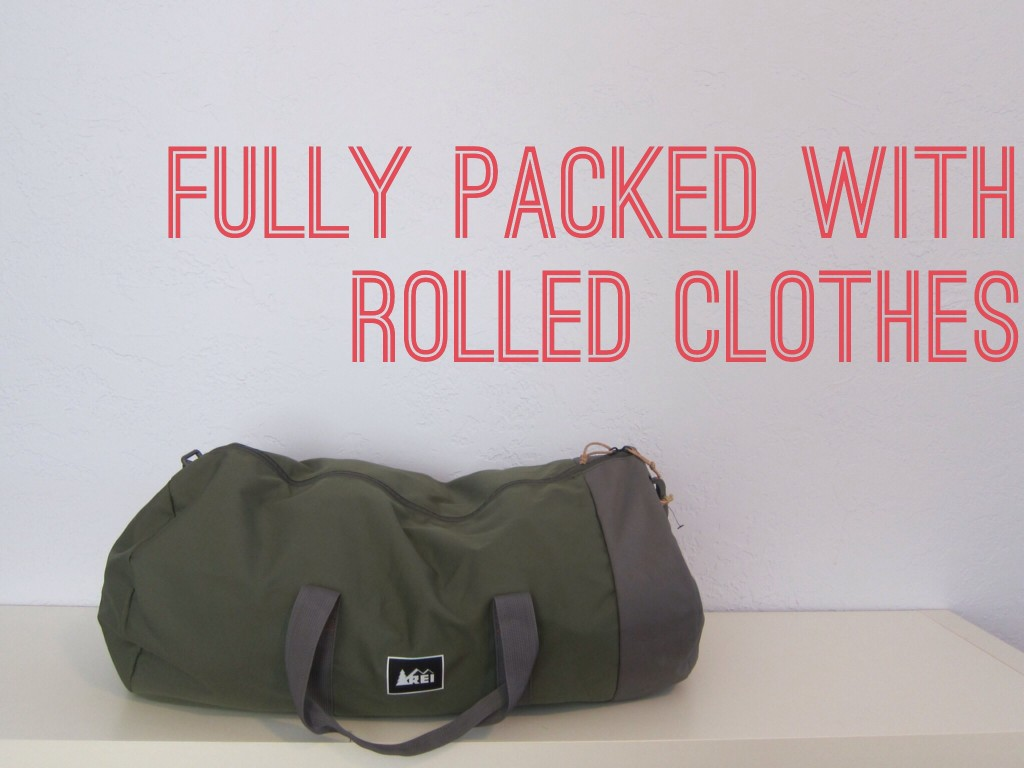 the packed bag with rolled clothes
