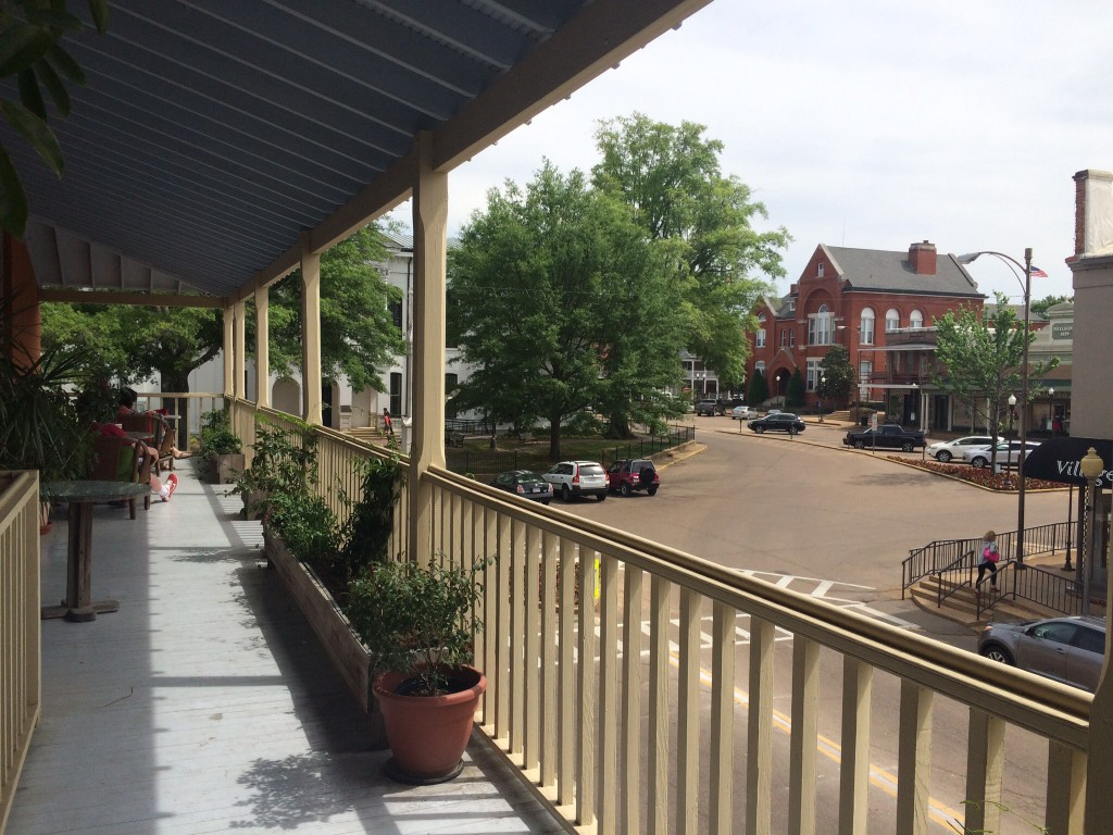 a view of the square in oxford, mississippi as seen from the balcony of square books store