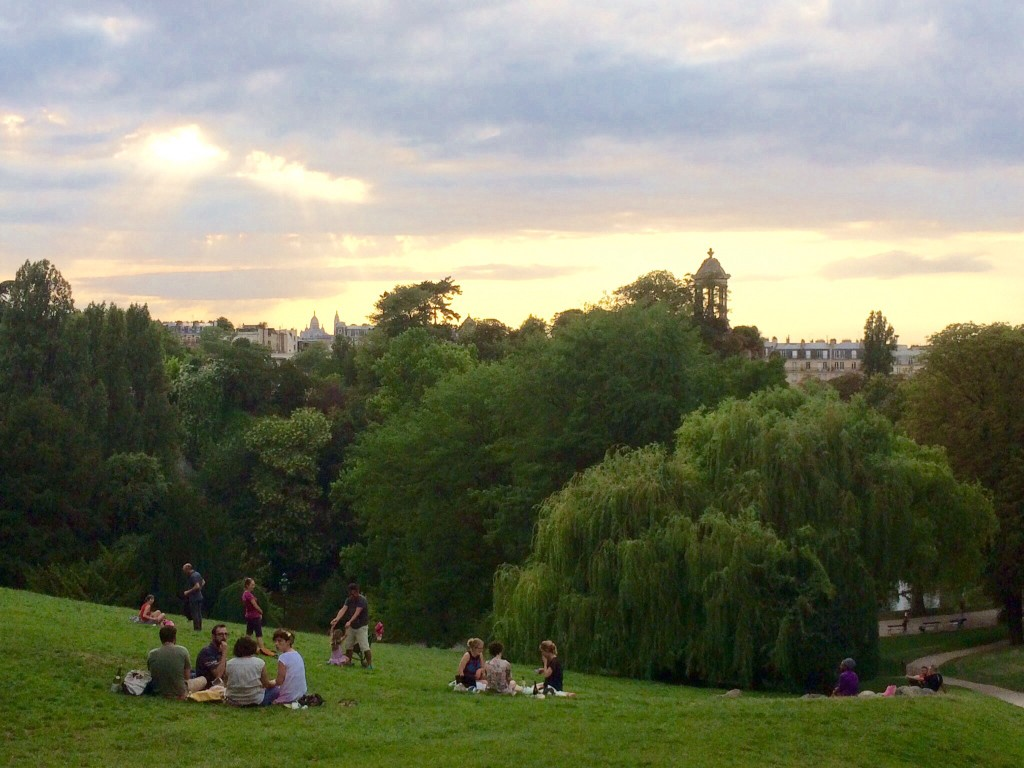 parisians picnic in the park while overlooking northeast paris