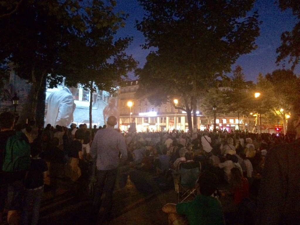 a public movie screening at the place de la république.